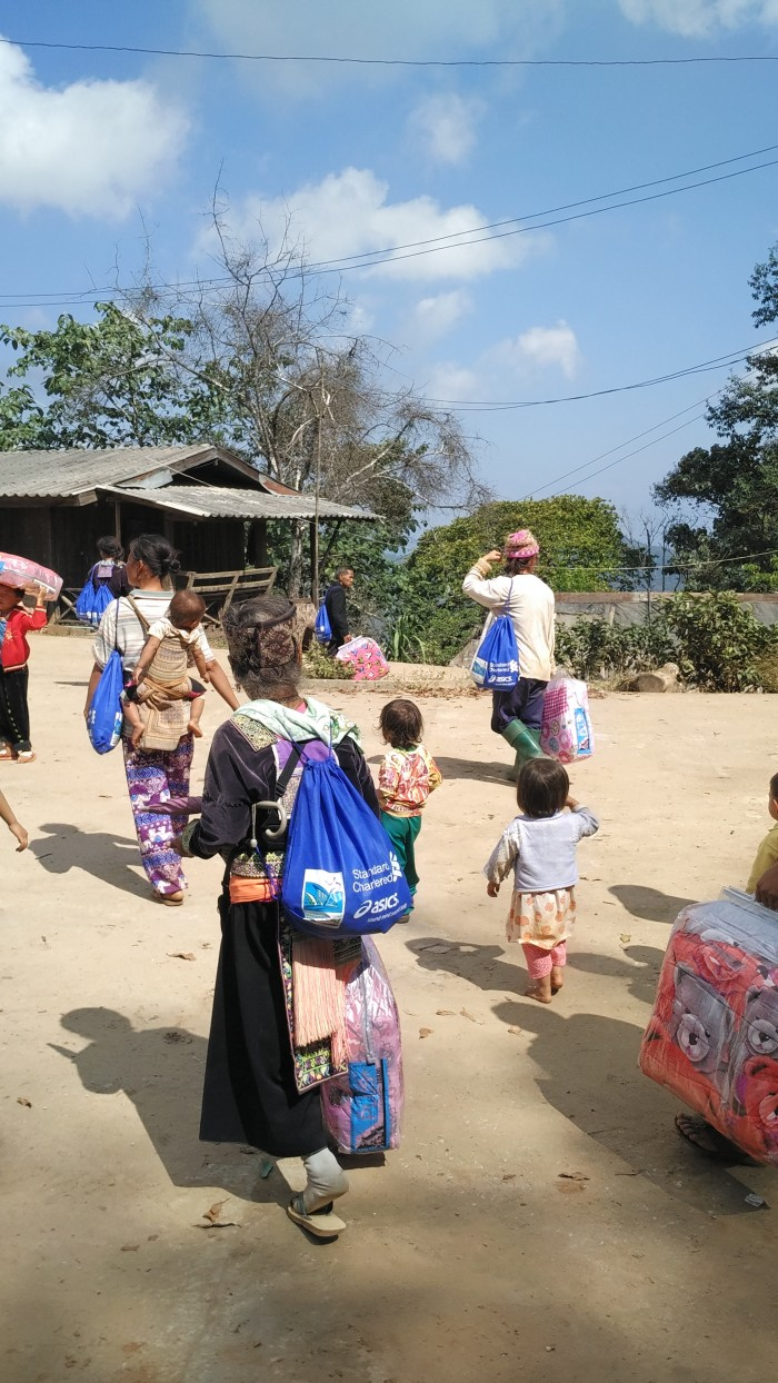 DRO5 - Villagers leaving with donated items from Singapore